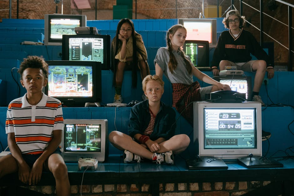 A group of people sitting at a computer