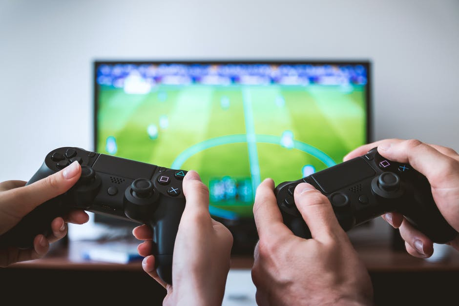 A hand holding a video game